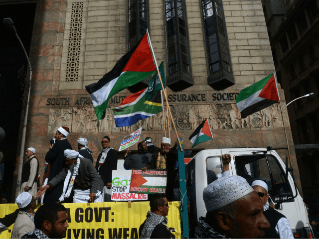 Muslims standing onto a truck, holding placards and waving Palestinian flags, take part to a demonstration in downtown Cape Town to protest Israel's military campaign in Gaza and show their support to the Palestinians people, on July 16, 2014. Israel urged 100,000 Gazans to flee their homes on July 16, …