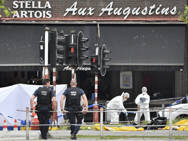Forensic police, right, investigate at the scene of a shooting in Liege, Belgium, Tuesday, May 29, 2018. A gunman killed three people, including two police officers, in the Belgian city of Liege on Tuesday, a city official said. Police later killed the attacker, and other officers were wounded in the shooting.(AP Photo/Geert Vanden Wijngaert)