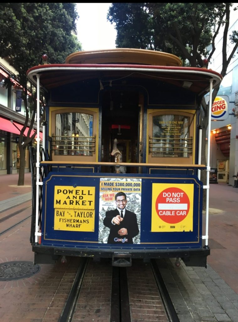 Sabo art mocking Google's CEO on a trolley