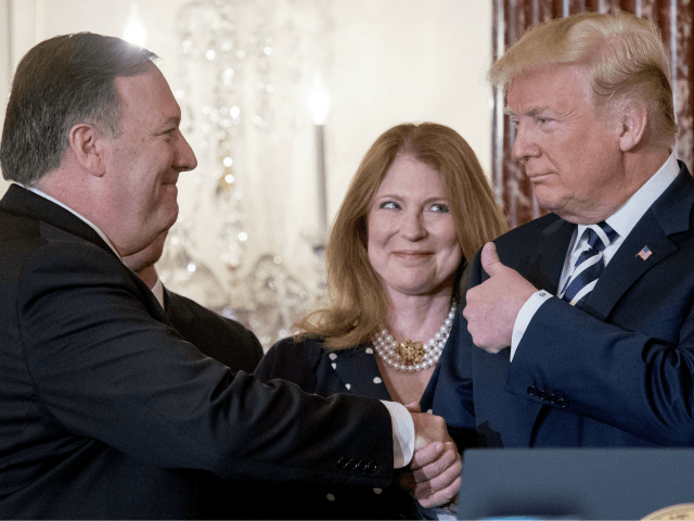 From left, Secretary of State Mike Pompeo, accompanied by his wife Susan, gets a thumbs up from President Donald Trump, after being ceremonially sworn in at the State Department, Wednesday, May 2, 2018, in Washington. (AP Photo/Andrew Harnik)
