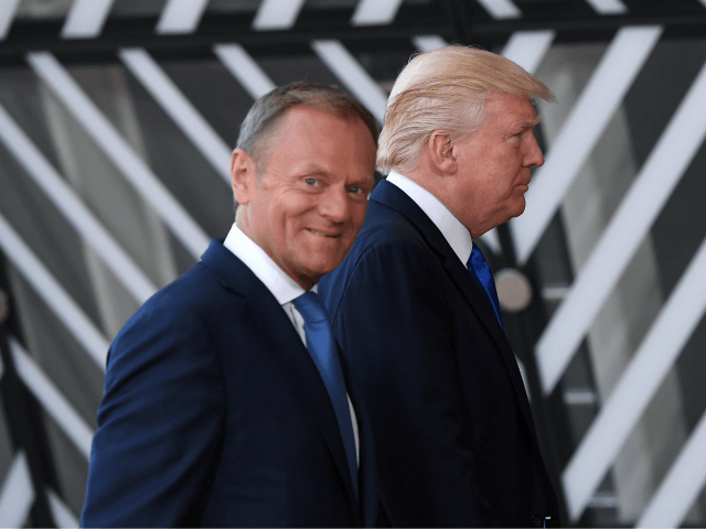 European Council President Donald Tusk (front C) welcomes US President Donald Trump (rear C) upon his arrival at EU headquarters, as part of the NATO meeting, in Brussels, on May 25, 2017. / AFP PHOTO / Emmanuel DUNAND (Photo credit should read EMMANUEL DUNAND/AFP/Getty Images)
