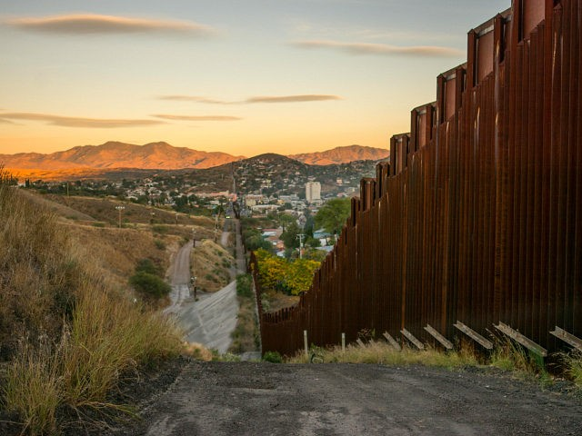 NOGALES, ARIZONA, UNITED STATES - 2017/11/14: The border wall at the US - Mexico border in the city of Nogales, Arizona According to the U.S. Customs and Border Protection there are at least 580 miles of physical barriers in place to divide United States and Mexico in 2009. The Trump …