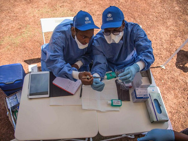 Nurses working with the World Health Organization (WHO) prepare to administer vaccines at the town all of Mbandaka on May 21, 2018 during the launch of the Ebola vaccination campaign. - The death toll in an outbreak of Ebola in the Democratic Republic of Congo (DRC) rose to 26 on …