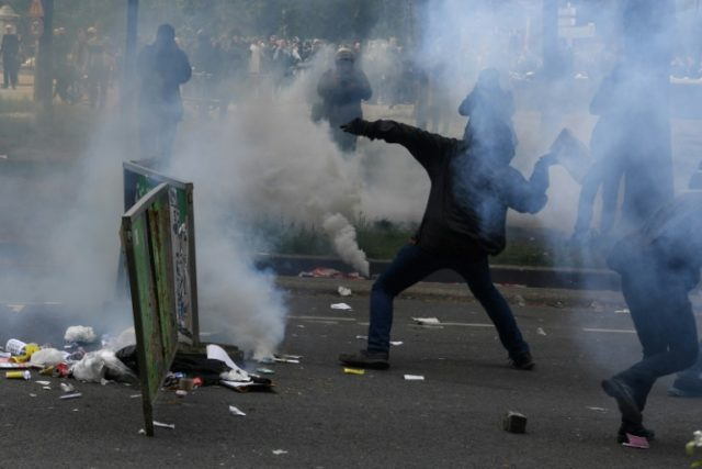 French anti-capitalist protesters clashed with police in Paris on Tuesday on the sidelines of a march for the annual May Day workers' rally