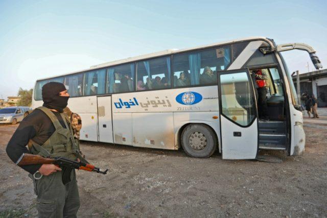 Dozens of jihadists arrive in north Syria under evacuation deal