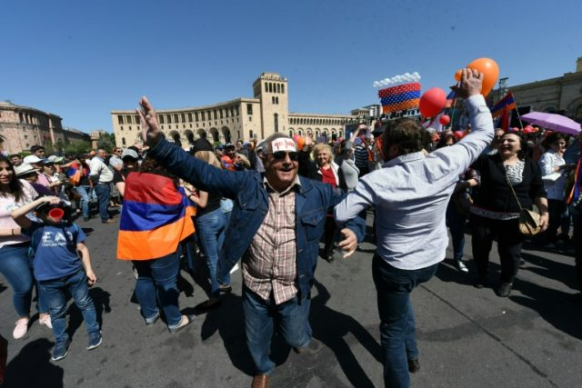 "Several thousand people gathered in the capital's Republic Square, waving Armenia's tricolour flags and balloons and chanting ""Pashinyan is prime minister!"""