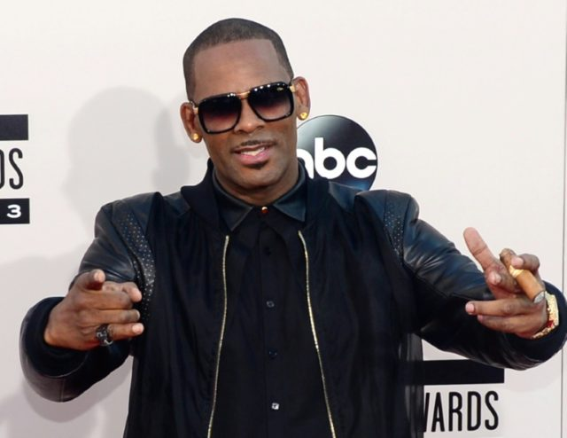 R&B singer R. Kelly, seen here in 2013 at the American Music Awards in Los Angeles, is fighting efforts to force him out of the music business over his alleged treatment of women and young girls