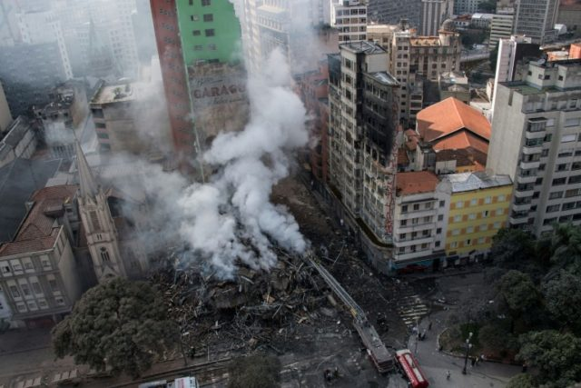 Firefighters work to extinguish the fire in a 24-storey building used by squatters that later collapsed in Sao Paulo, Brazil, the largest city in Latin America