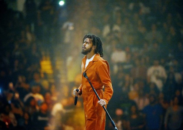 "American hip-hop artist J. Cole, pictured performing in 2017, raps about the dangers of drugs on ""KOD,"" which has three simultaneous meanings -- ""Kids on Drugs,"" ""King Overdosed"" and ""Kill Our Demons"""