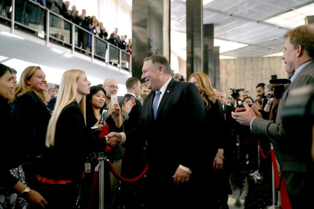 """US Secretary of State Mike Pompeo greets staffers by saying, """"Hi, I'm Mike,"""" during a welcome ceremony at the State Department"""
