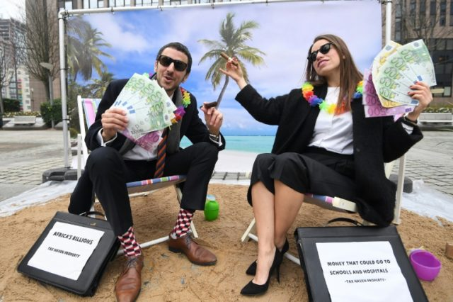 Britain demands overseas tax havens open up