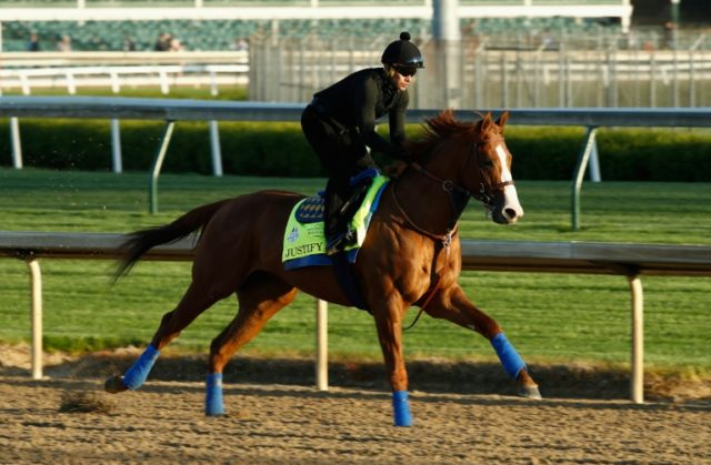 Justify runs on the track during the morning training for the Kentucky Derby at Churchill Downs on May 1, 2018 in Louisville, Kentucky