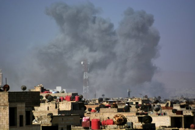 Smoke billows from a southern district of the Syrian capital Damascus during regime strikes targeting the Islamic State group in the Palestinian camp of Yarmuk, and neighbouring districts, on April 20, 2018