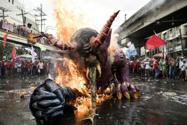 Activists in Manila voiced anger over Philippine President Rodrigo Duterte's economic policies
