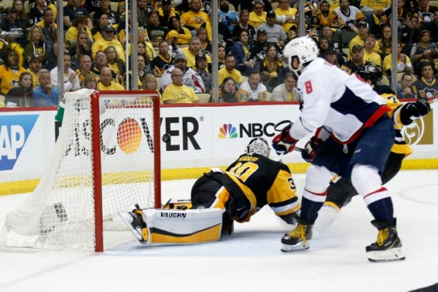 Alex Ovechkin of the Washington Capitals flips the puck past Matt Murray of the Pittsburgh Penguins for the game winning goal as Washington won 4-3 to take a 2-1 series lead