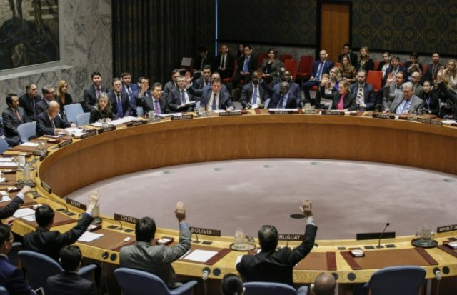 Members of the UN Security Council vote 15-0 to impose new sanctions on North Korea during a Security Council meeting in December 2017, at UN Headquarters in New York City