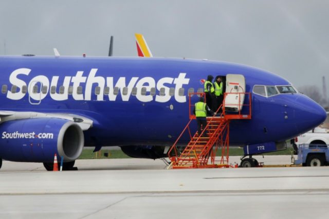A Southwest Airlines jet sits on the runway at Philadelphia International Airport after it was forced to land with an engine failure, in Philadelphia, Pennsylvania, on April 17, 2018