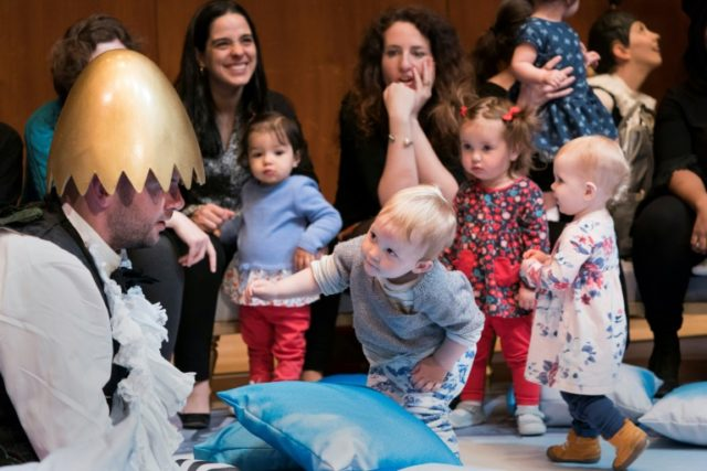 """The character Pulcino, played by Timothy Connor, performs """"BambinO"""" for children and parents at the Metropolitan Opera House in New York"""