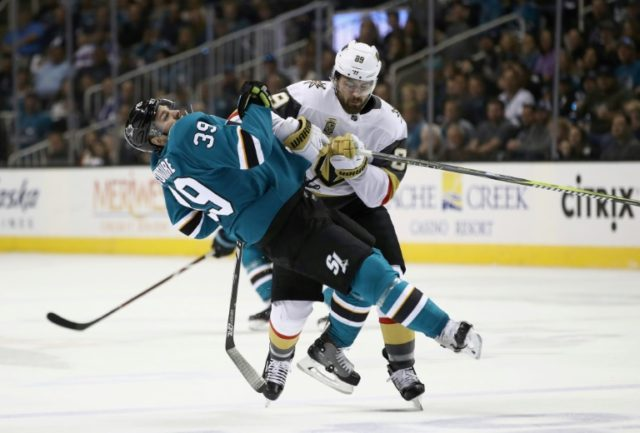 Logan Couture of the San Jose Sharks gets checked by Alex Tuch of the Vegas Golden Knights during game three of the Western Conference playoffs