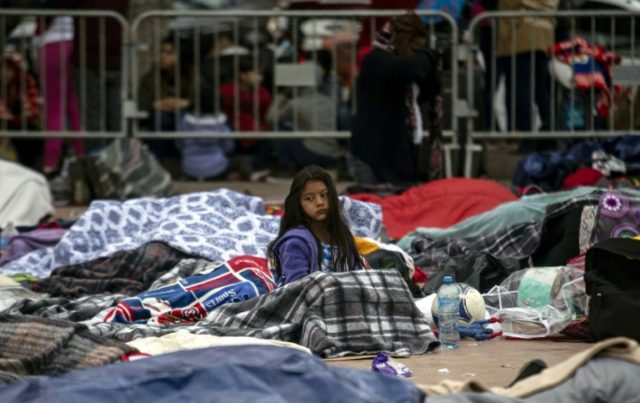 Central Americans in a migrant caravan camp out at US-Mexico border, awaiting their chance to seek asylum in America