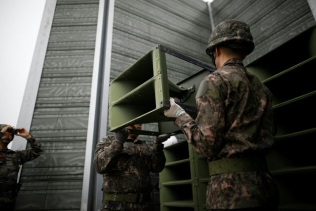 South Korean soldiers dismantle loudspeakers that were set up for propaganda broadcasts near the demilitarized zone separating the two Koreas in Paju on May 1, 2018, as hopes grow for a peace settlement