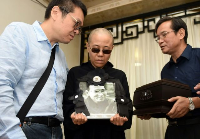 Chinese laureate's widow willing to 'die at home' in protest