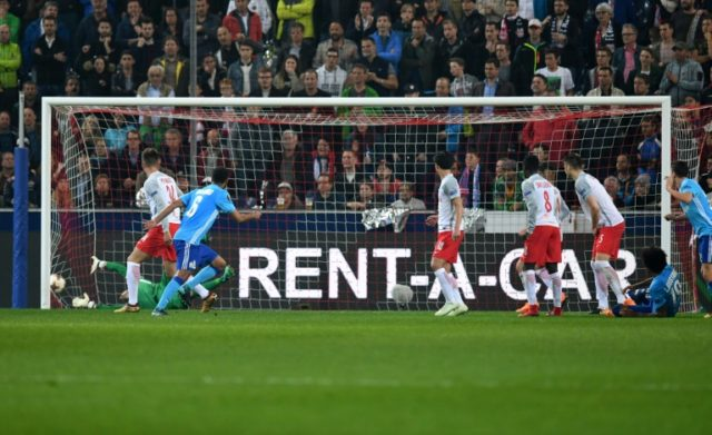 Rolando's volley found its way into the corner to send Marseille through to the Europa League final
