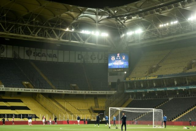 Fenerbahce's players warm up prior to the rescheduled Turkish Cup semi second leg final football match between Fenerbahce and Besiktas on May 3, 2018 at Sukru Saracoglu Stadium in Istanbul, which was then called off