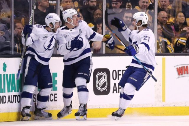 Ondrej Palat #18 of the Tampa Bay Lightning celebrates with Tyler Johnson #9 and Brayden Point #21 after scoring a goal against the Boston Bruins during the 2018 NHL Stanley Cup Playoffs on May 2, 2018 in Boston, Massachusetts