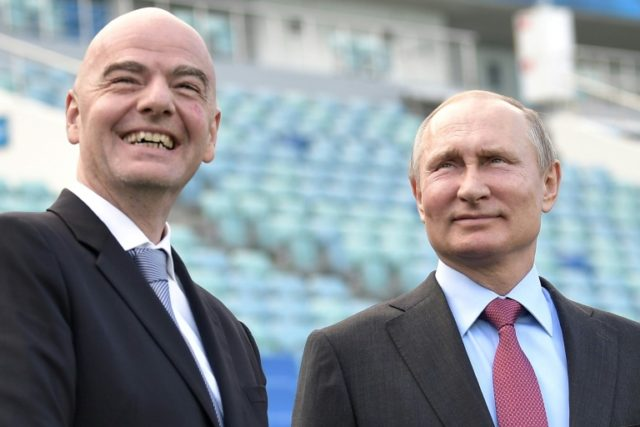 FIFA president Gianni Infantino (L) and Russian president Vladimir Putin visit the Fisht Stadium in the Black Sea resort of Sochi