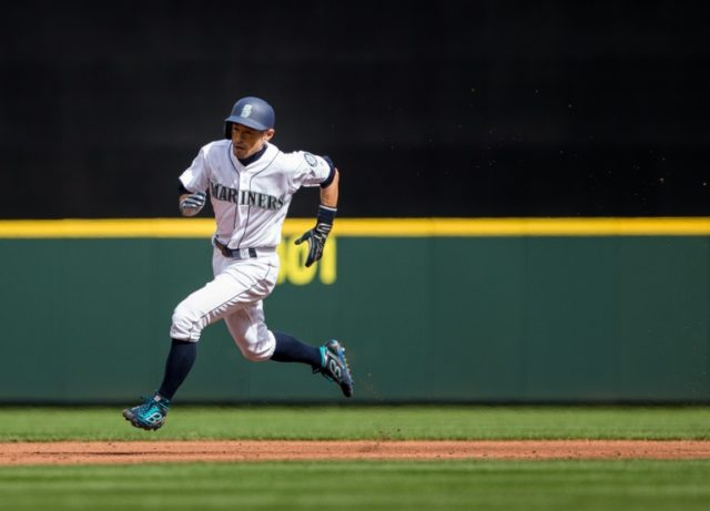 Ichiro Suzuki of the Seattle Mariners reaches third base on a hit by Dee Gordon of the Seattle Mariners in the third inning against the Cleveland Indians at Safeco Field on March 31, 2018 in Seattle, Washington