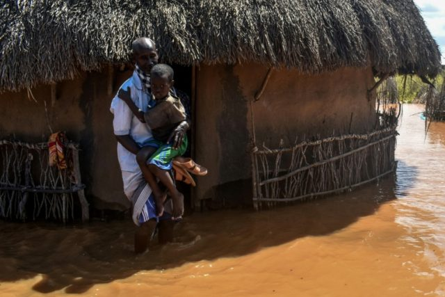 Villagers at Onkolde in Kenya's Tana River delta region struggled with flood water after the river burst its banks. More than 60,000 people have displaced from the area, according to the Kenya Red Cross.