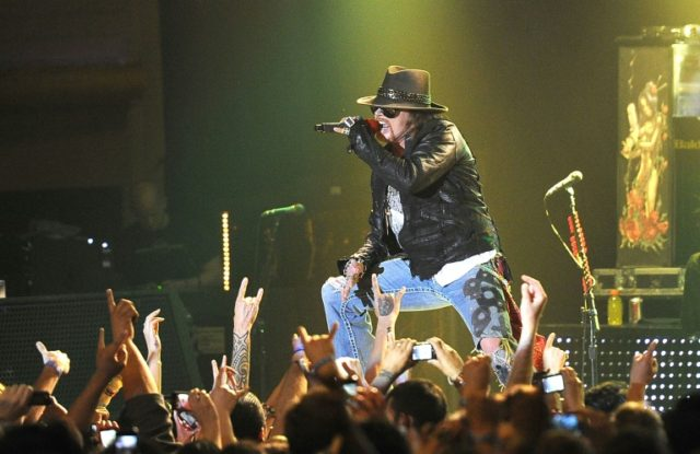Singer Axl Rose of Guns N' Roses, shown at a 2012 performance, reunited with guitarist Slash in 2016 for a tour that has been repeatedly extended