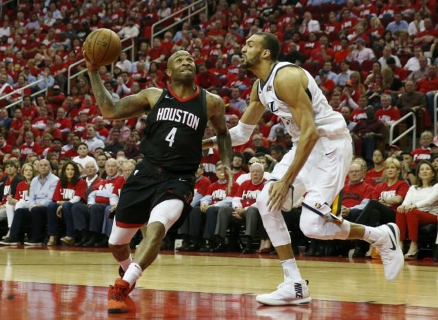 PJ Tucker #4 of the Houston Rockets goes up for a lay up defended by Rudy Gobert #27 of the Utah Jazz during the 2018 NBA Playoffs in Houston, Texas