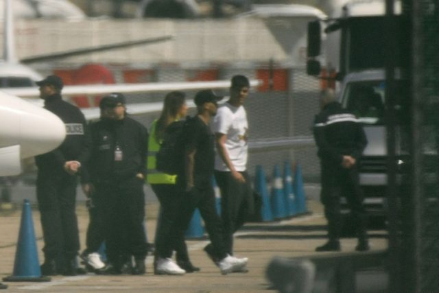 Neymar, pictured in a black t-shirt, arrived on a private jet at Le Bourget airport outside Paris