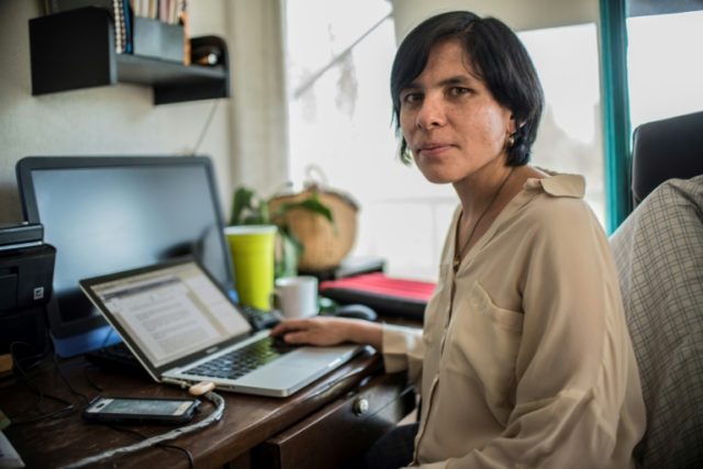 Mexican journalist Daniela Rea, is pictured while working at her home in Mexico City, on April 18, 2018