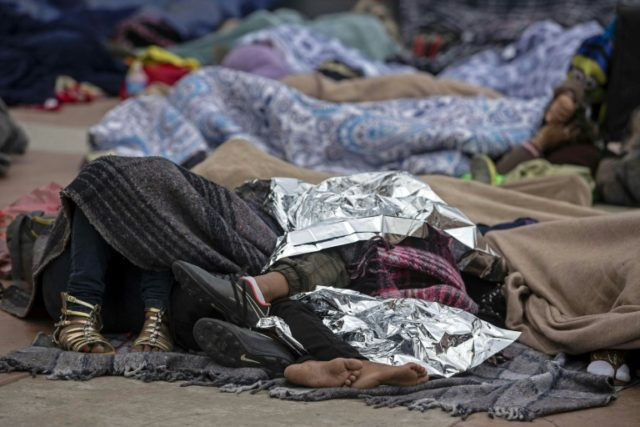 "Central American migrants travelling in the ""Migrant Via Crucis"" caravan sleep outside ""El Chaparral"" port of entry to US while waiting to be received by US authorities, in Tijuana, Baja California State, Mexico on April 30, 2018 According to the U.S. Customs and Border Protection on Sunday, none of the …"