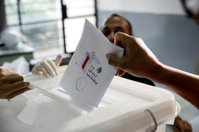 A Lebanese man casts his vote in the country's first parliamentary election in nine years on May 6, 2018 as ruling parties expect to preserve a fragile power-sharing arrangement despite regional tensions