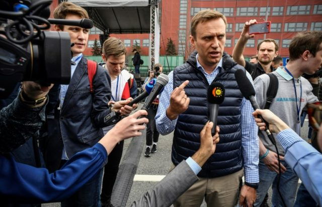 Russian opposition leader Alexei Navalny talks to media during an opposition rally in central Moscow on April 30, 2018