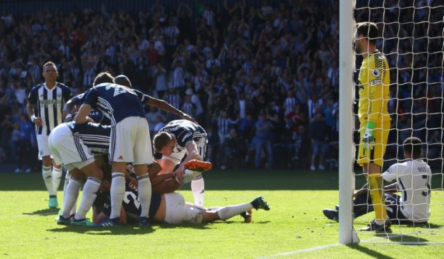 Jake Livermore's dramatic goal in stoppage time gave West Bromwich Albion a 1-0 victory over Tottenham Hotspur on Saturday that kept alive their faint hopes of a miraculous escape from Premier League relegation