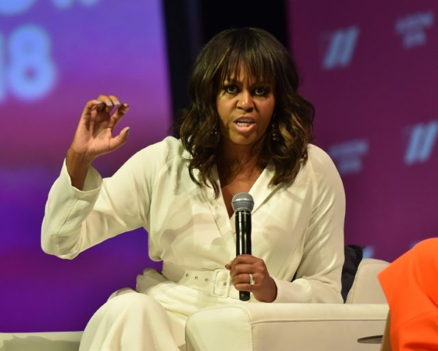Former US first lady Michelle Obama attends the United State of Women Summit at the Shrine Auditorium in Los Angeles