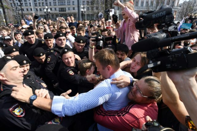 Russian police detain opposition leader Alexei Navalny during an unsanctioned anti-Putin rally on Saturday