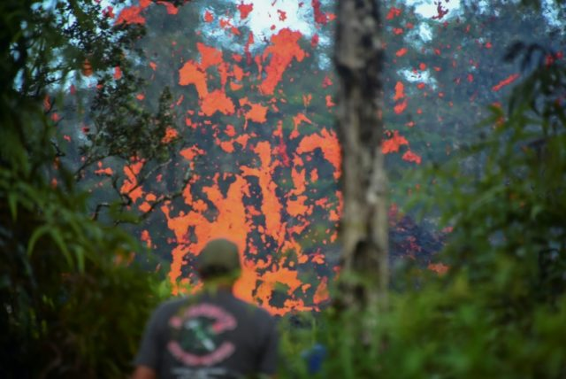 Lava spits from a fissure in the Leilani Estates subdivision on Hawaii's Big Island after earthquakes prompted the Kilauea volcano to erupt