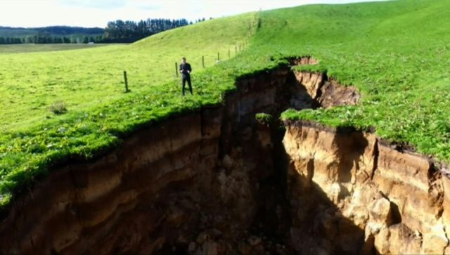 This frame grab from TVNZ video footage taken on May 2, 2018 and released to AFP on May 7 shows a sinkhole that appeared on a dairy farm near Rotorua on New Zealand's North Island. AFP Photo / TVNZ