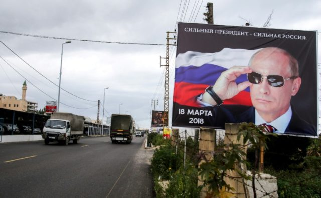 Vladimir Putin, seen here on a billboard in south Lebanon, has stamped his total authority in Russia, silencing opposition and reasserting Moscow's lost might abroad