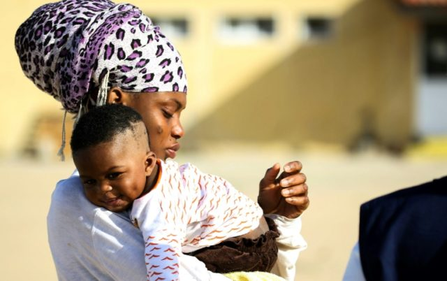 Migrants of different African nationalities arrive at a naval base in the capital Tripoli