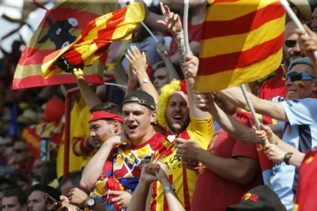 Perpignan's supporters cheer their team in Toulouse southern France