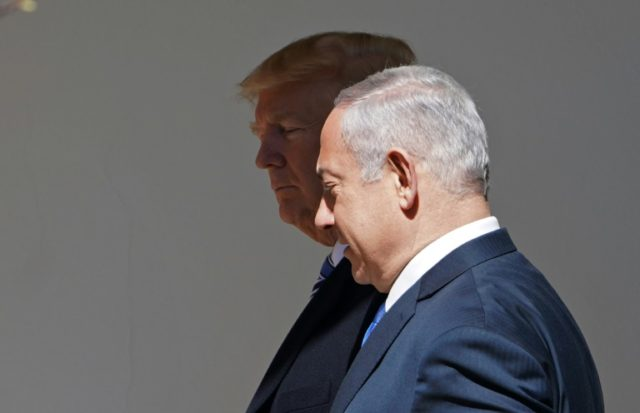 US President Donald Trump and Israel's Prime Minister Benjamin Netanyahu make their way to the Oval Office for a meeting at the White House on March 5, 2018 in Washington, DC