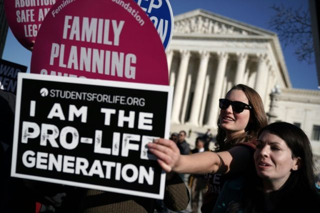 An Iowa bill banning abortions once a fetal heartbeat is detected is expcted to trigger a legal battle, which conservatives hope will land the flashpoint social issue back at the US Supreme Court