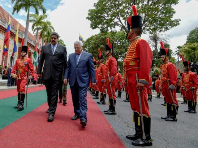 Venezuelan President Nicolas Maduro, left, welcomes Palestinian President Mahmud Abbas to Caracas on May 7, 2018